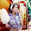 Young American Woman in Amusement Park Eating Cotton Candy — Stock Photo