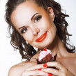 Gourmet. Happy Young Woman holding Cupcake with Whipped Cream — Stok fotoğraf