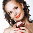 Gourmet. Happy Young Woman holding Cupcake with Whipped Cream — Foto de Stock