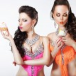 Stock Photo: Foretaste. Two Women holding Appetizing Cupcakes with Whipped Cream