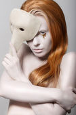Stylized Woman with Carnival Venetian Mask. Masquerade. Platinum Makeup with Golden Teardrops — Stock Photo
