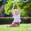 Stock Photo: Wellness. Mental Health. Optimistic Old WomExercising in Open Air