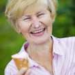 Contentment. Jubilant Ecstatic Old Woman Holding Ice-Cream and Laughing — Stock Photo #38672377