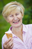Contentment. Jubilant Ecstatic Old Woman Holding Ice-Cream and Laughing — Stock Photo