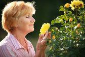 Expression. Senior Woman Model with Garden Roses. Springtime — Stock Photo
