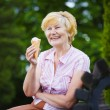 Grey-Haired Woman Relaxing with Ice-Cream on Bench in the Park — Stock Photo #38738779