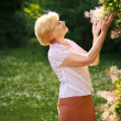 Gardening. Gracious Senior Woman and Flowers — Stock Photo