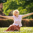 Gladness. Meditation. Mature Pleased WomRelaxing with Outspread Arms — Stock Photo #38739047