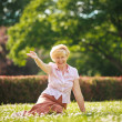 Enjoyment. Positive Emotions. Outgoing Old WomResting on Grass — Stockfoto #38739161