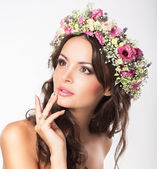 Young Beauty. Woman's Face with Bouquet of Natural Flowers — Stock Photo