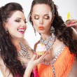Stock Photo: Unbalanced Diet Concept. Women Gourmets with Delicious Cupcakes. Series of Photos