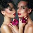 Flirt. Portrait of Two Voluptuous Romantic Women with Violet Orchids — Stock Photo