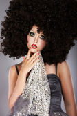 Futurism. Fanciful Girl in Huge Unusual Black African Frizzy Wig — Stock Photo