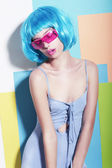 Eccentric Extravagant Woman in Styled Blue Wig and Pink Sunglasses — Stock Photo