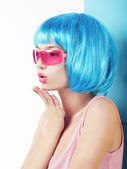 Manga Style. Profile of Charismatic Woman in Blue Wig Blowing a Kiss — Stock Photo