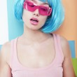 Styling. Portrait of Showy Woman with Blue Hairs over Patchwork Wall — Stock Photo #42354677