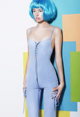 Vogue. Shapely Young Woman in Blue Overalls and Creative Wig posing — Stock Photo