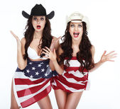 Two Funny Happy Women in Hats Wrapped in USA Flag — Stock Photo