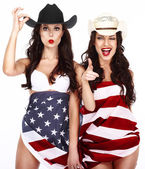 Two Ecstatic Showy Women Wrapped in USA Flag — Zdjęcie stockowe