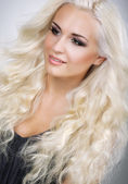 Classy Glamorous Blonde with Waved and Frizzy Hair — Stock Photo
