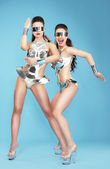 Night Life. Two Glamorous Women Dancers in Fantastic Masks — Stock Photo