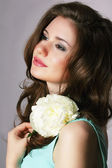Femininity. Sincere Brunette with White Peony — Stock Photo