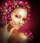 Radiance. Beautiful Golden Girl With Purple Tulips Flowers — Stock Photo