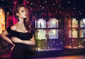 Fantasy. Beautiful Lady over Shop Window with Jewels — Stock Photo