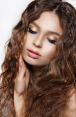 Daydreaming Brunette with Curly Hair and Blue Eyeshadows — Stock Photo