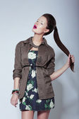 Trendy Fashion Model in Elegant Clothes holding her Tress — Stock Photo