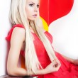 Sexy young female blonde posing in studio over red heart — Stock Photo #8970427