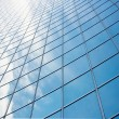 Reflection of sky at building glass - Stock Photo