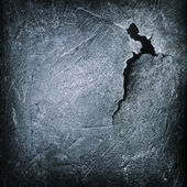 Crack at black iron cast surface abstract grunge background — Stock Photo