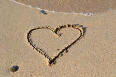 Heart written in the sand — Stock Photo