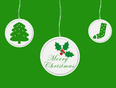 Christmas card with green ornaments — Stock Photo