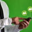 Businessman using a smartphone with virtual icons — Stock Photo #48013621