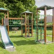 Childrens outdoor wooden Climbing & sliding frame with ropes — Stock Photo #14209597