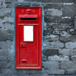 Stock Photo: Red post box set in wall