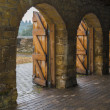 Stock Photo: Stone archways with wooden doors