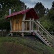 Stock Photo: Childrens wooden playhouse