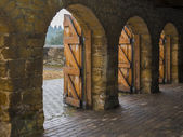 Stone archways with wooden doors — Stock Photo