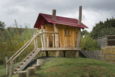 Childrens wooden playhouse — Stock Photo