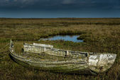 Old and decaying isolated wooden rowing boat — Stock Photo