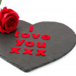 Stock Photo: I love you with red rose on heart shaped slate with white