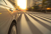 Driving in the sunset city — Stock Photo