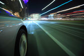 Driving in the night city — Stockfoto