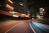 Driving on the night road — Stock Photo