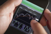 Foreign exchange market chart at smart phone — Stock Photo