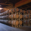 Stock Photo: Inside winery cavern with oak barrels and vats, fermentation and storage tanks