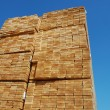 Foto Stock: Lumber stacked